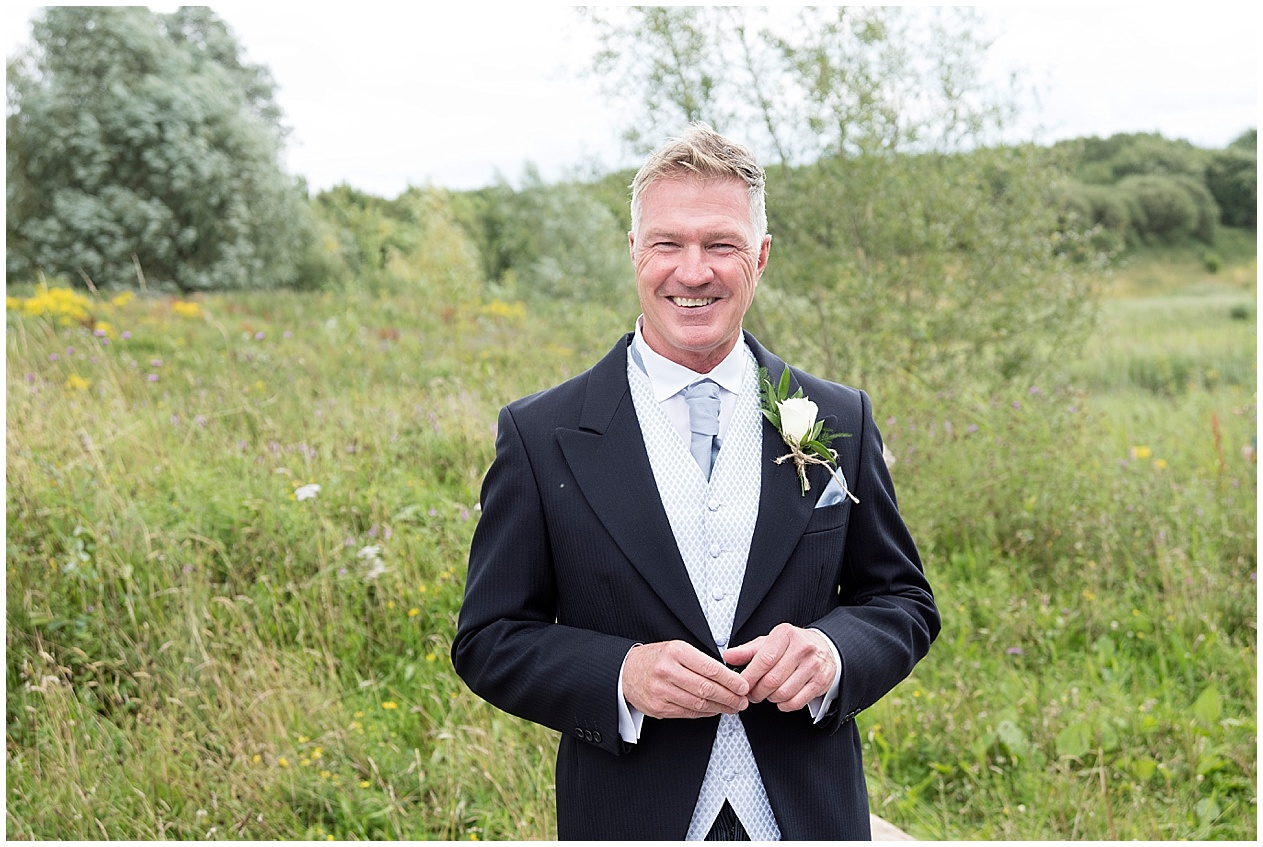 Proud dad waits for his daughter to arrive at her wedding at Brockholes nature reserve in Preston.