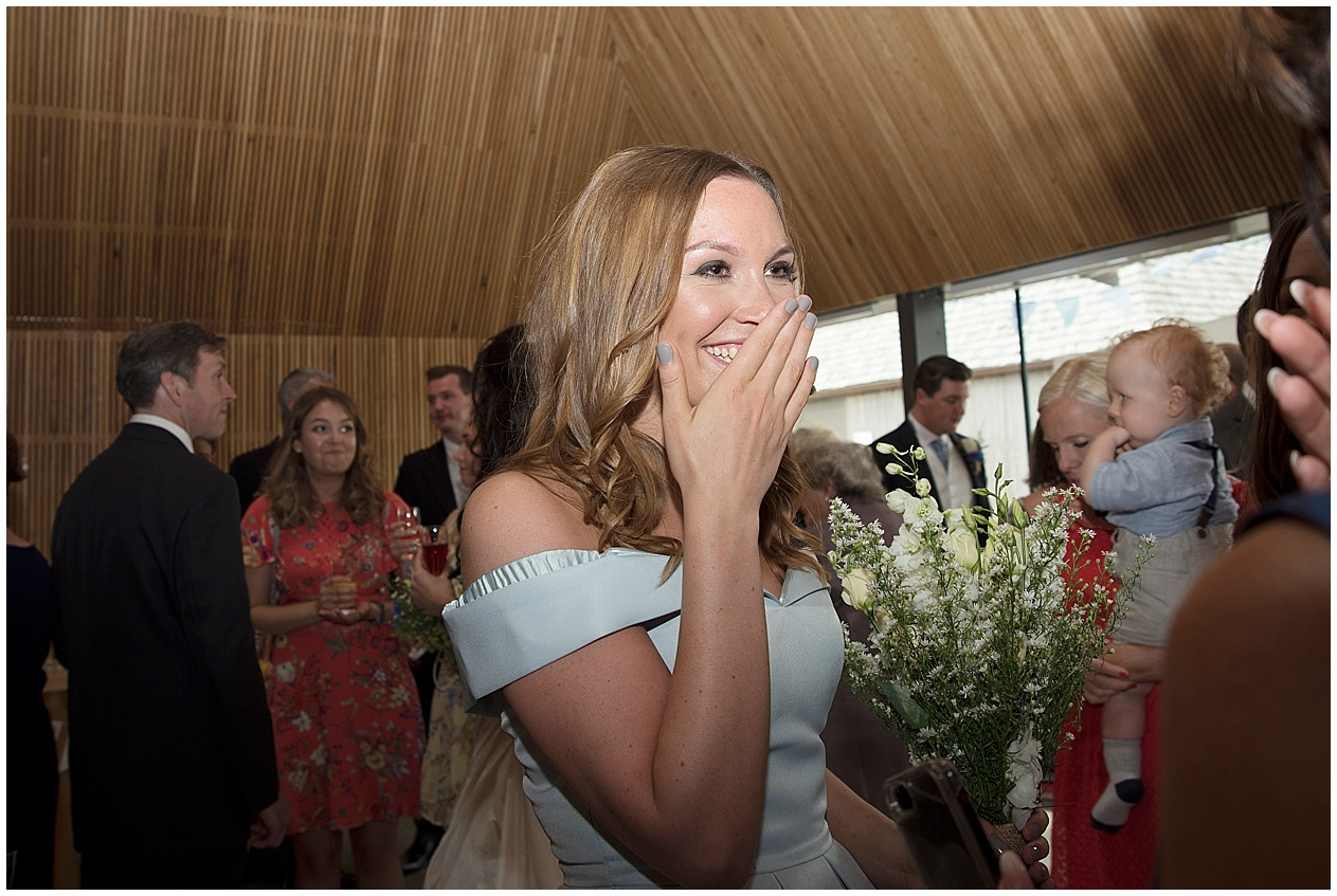 Bridesmaid laughing at a wedding in Lancashire.