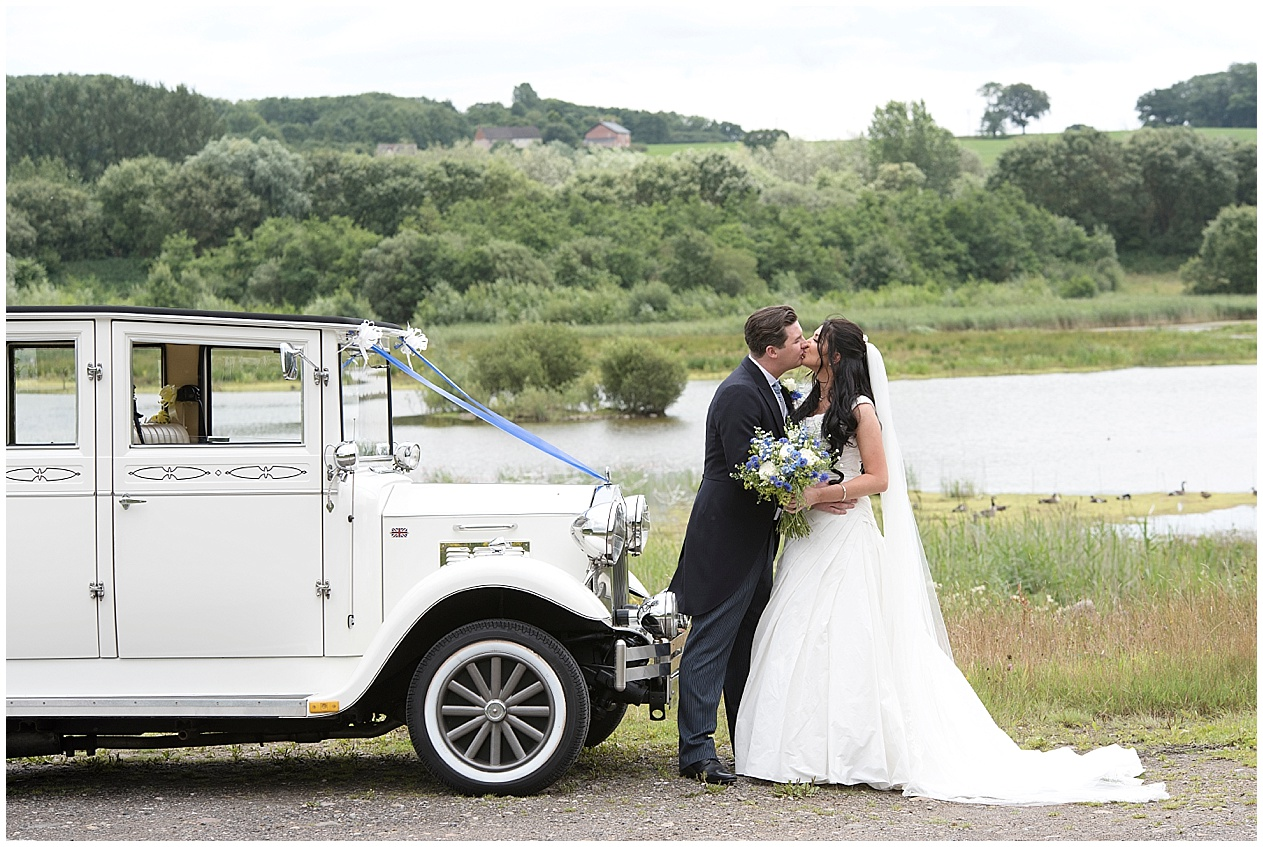 Lancashire wedding photographer. Bride and groom photographed with their wedding car.