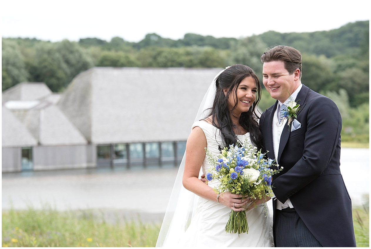 Happy bride and groom on their wedding day at Brockoles nature reserve in Preston.