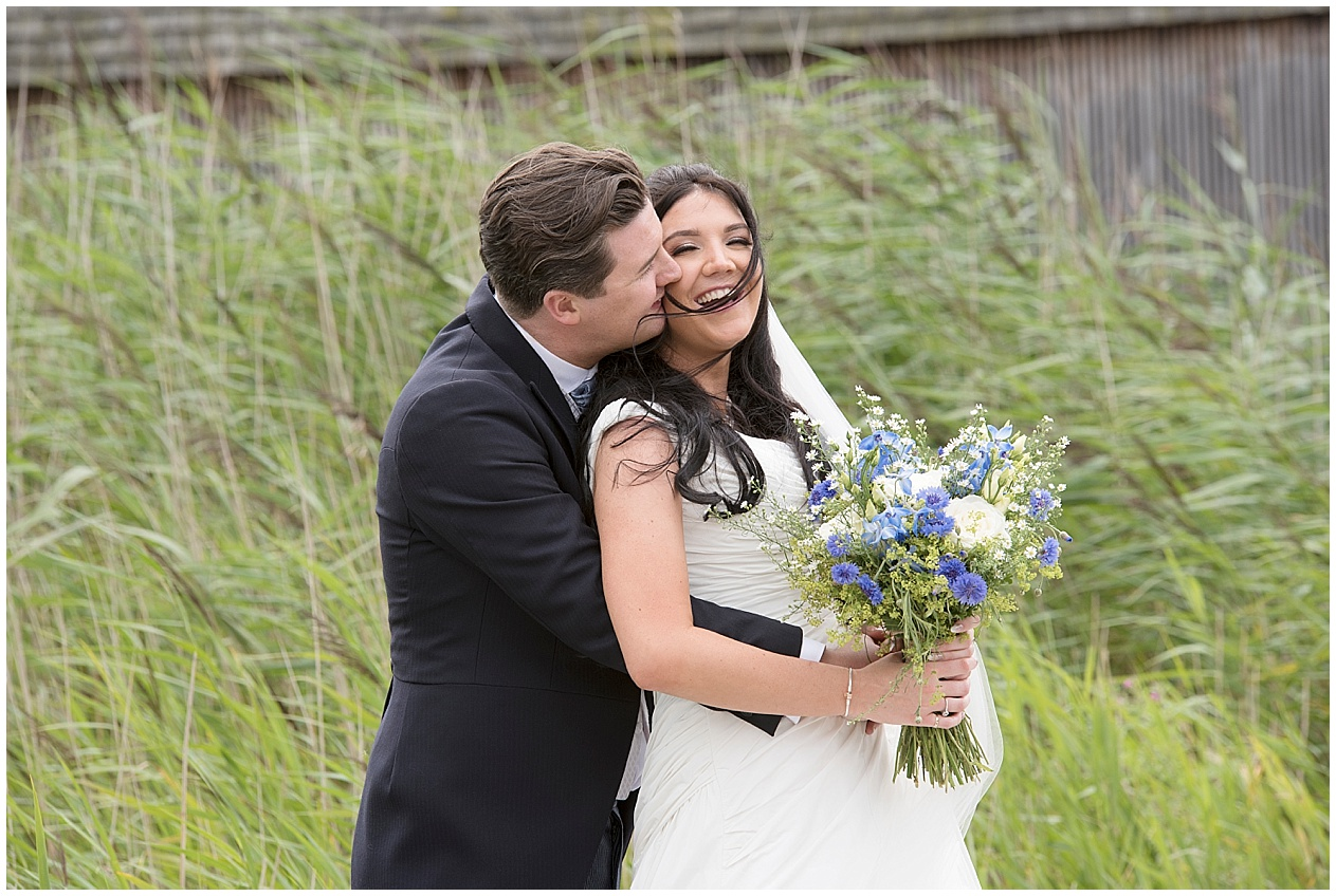 Bride and groom smiling. Brockholes nature reserve wedding photography.