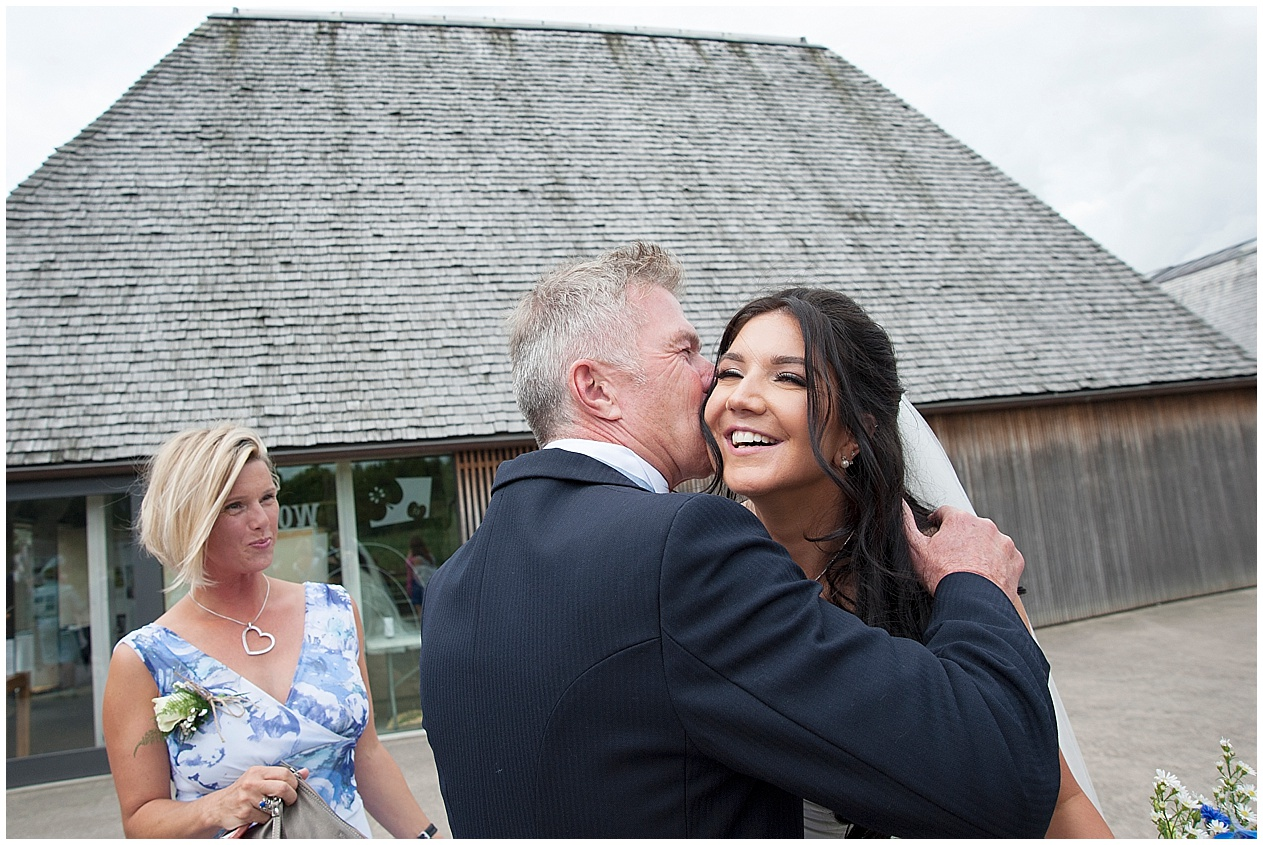 A bride gets a kiss from her dad on her wedding day in Lancashire.