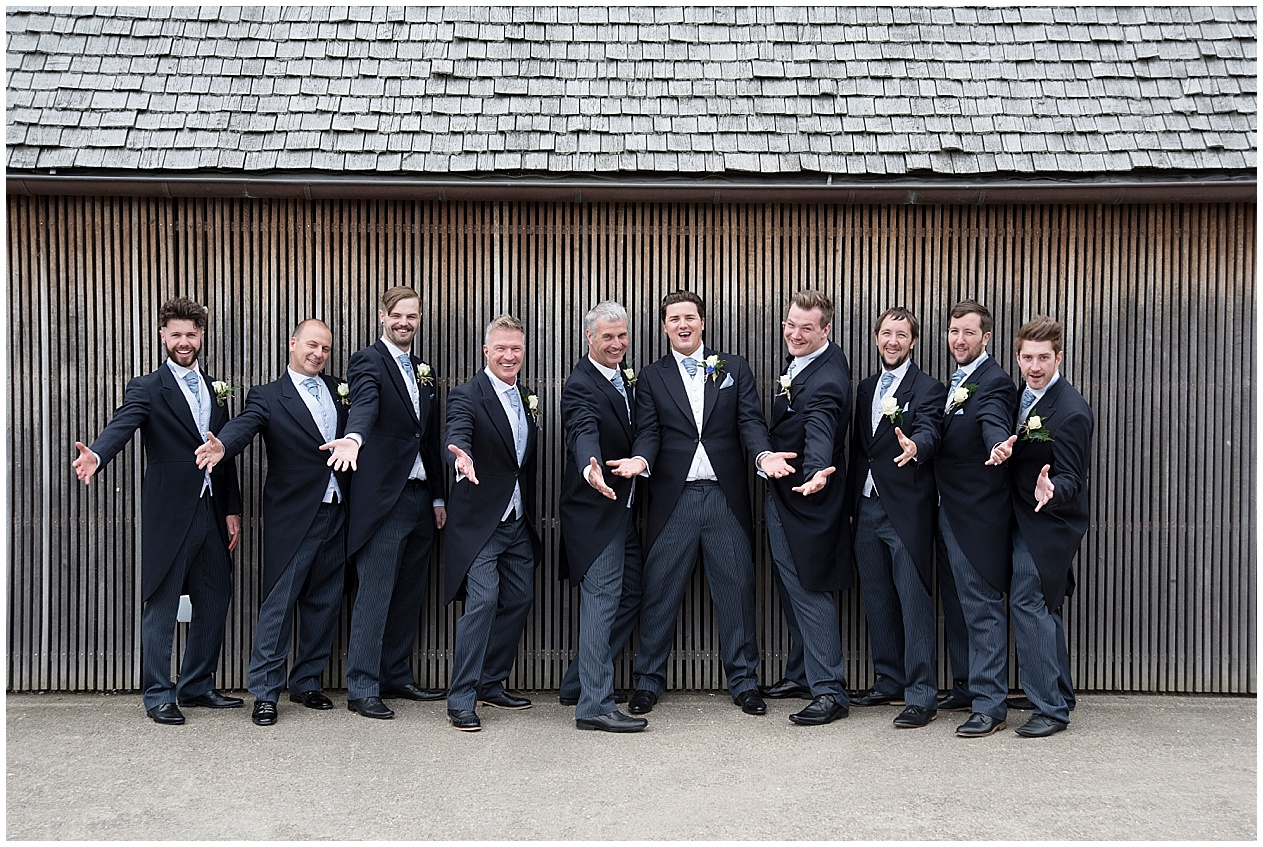 The groom and his groomsmen pictured on the floating island at Brockholes.