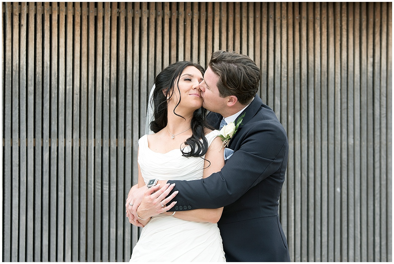 Bride and groom share a kiss on their wedding day in Preston. Lancashire wedding photographer.