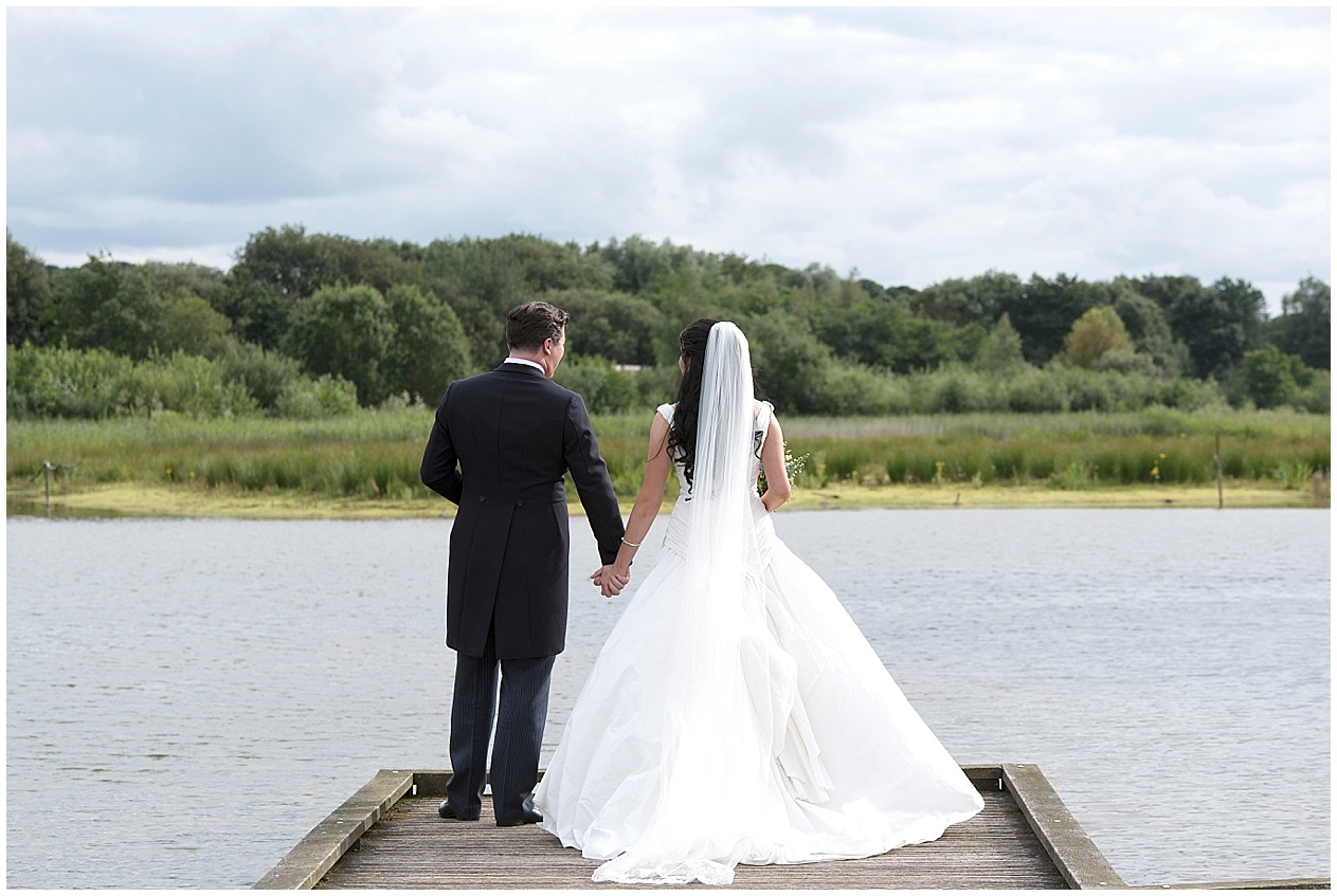Bride and groom pictured on their wedding day at Brockholes nature reserve in Preston. Lancashire wedding photographer.