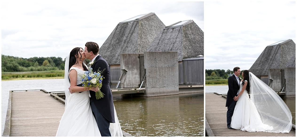 Bride and groom share a kiss on their wedding day at Brockholes nature reserve . Lancashire wedding photographer.