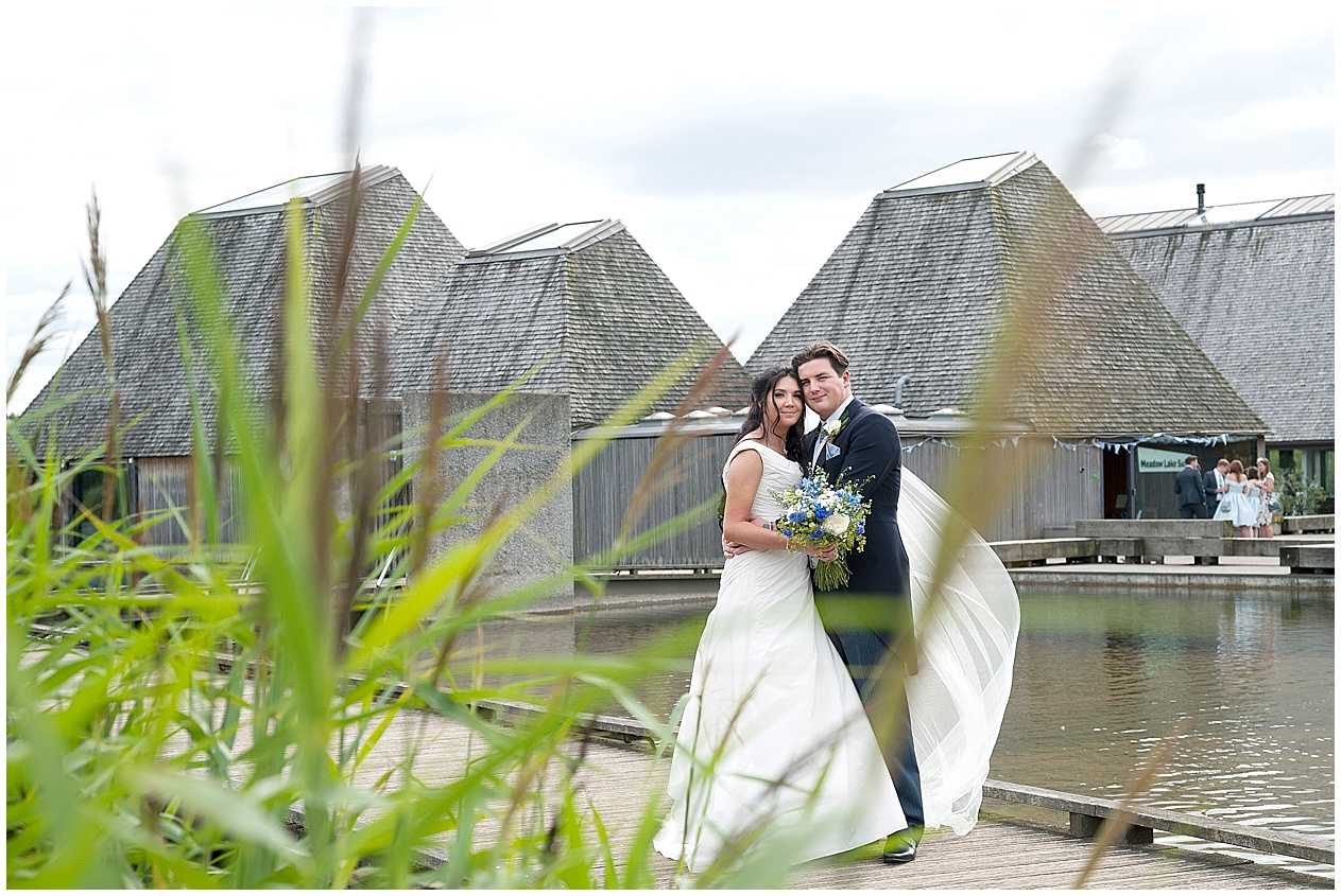 Brockholes nature reserve wedding photography. Bride and groom pictured on the jetty.