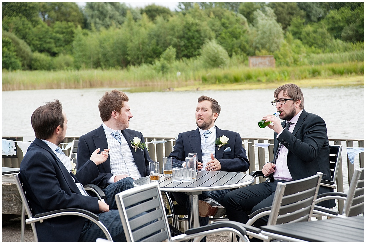 Guests relax and enjoy a beer during a wedding at Brockholes in Preston.