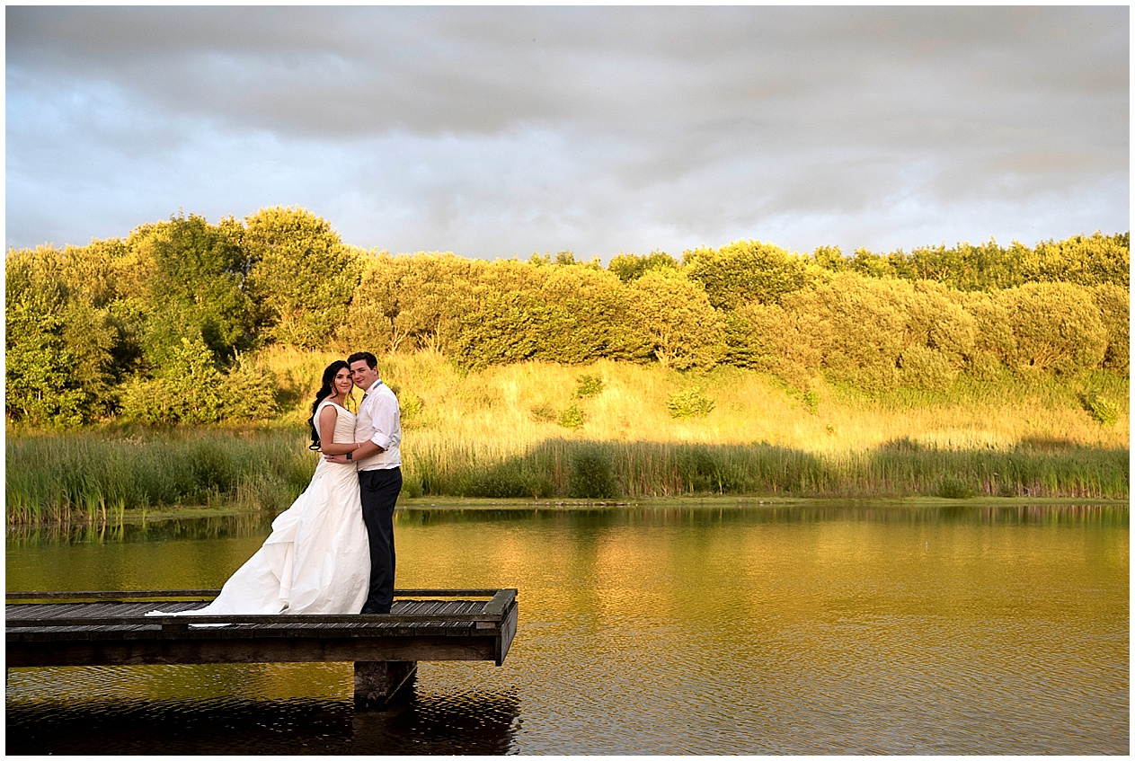 Bride and groom pictured on the Jetty at their wedding at Brockholes nature reserve in Lancashire.