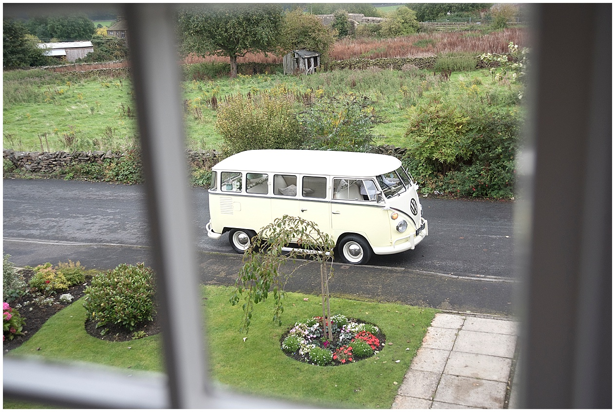 Camer van wedding car arrives to pick up a bride on her wedding day in Lancashire.