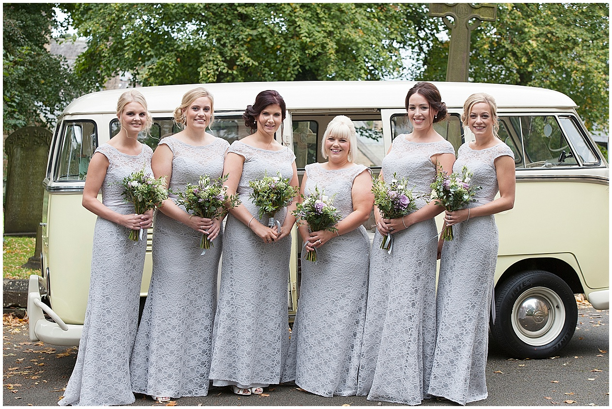 Bridesmaids pictured by a camper van Stirk house wedding photography.