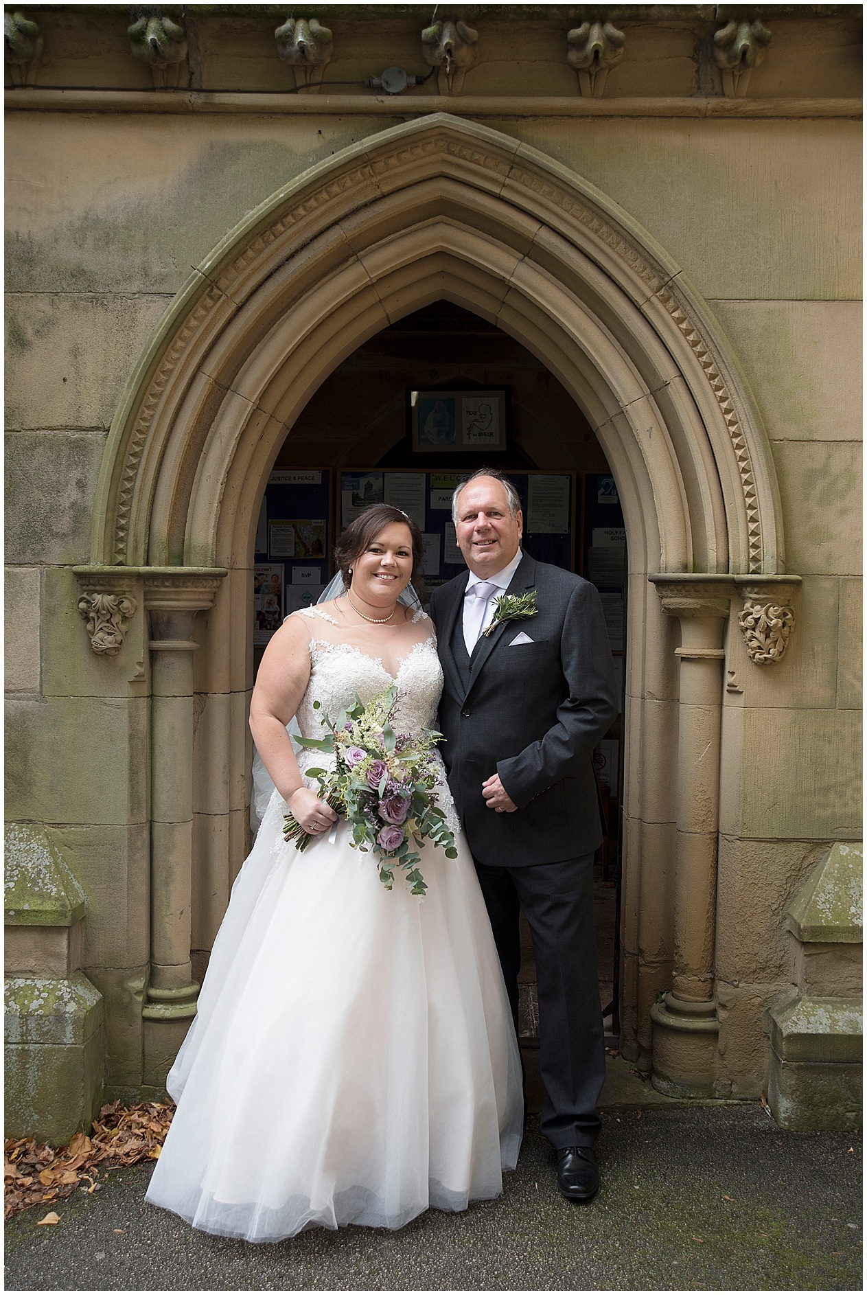 The bride photographed with her father outside church on her wedding day in Lancashire.
