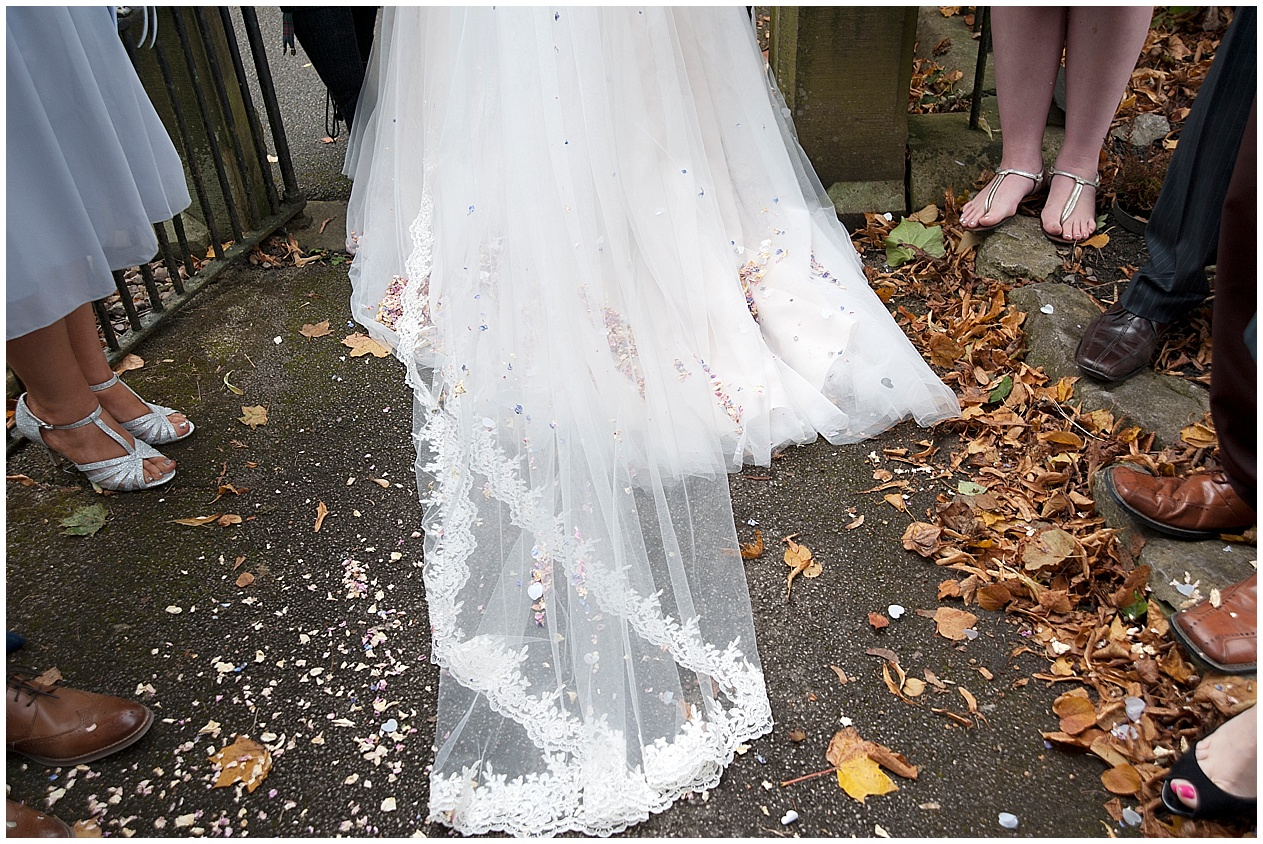 Brides dress and autumnal leaves.