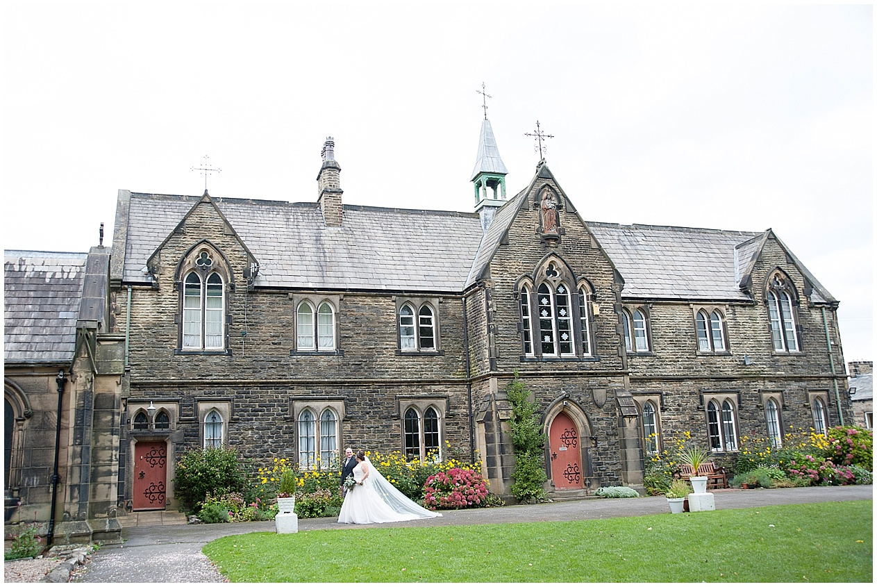 Bride and groom pictured outside church on their wedding day in Lancashire.