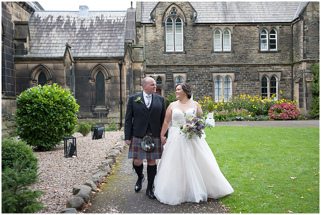 Lancashire wedding photographer. The bride and groom pictured outside church.