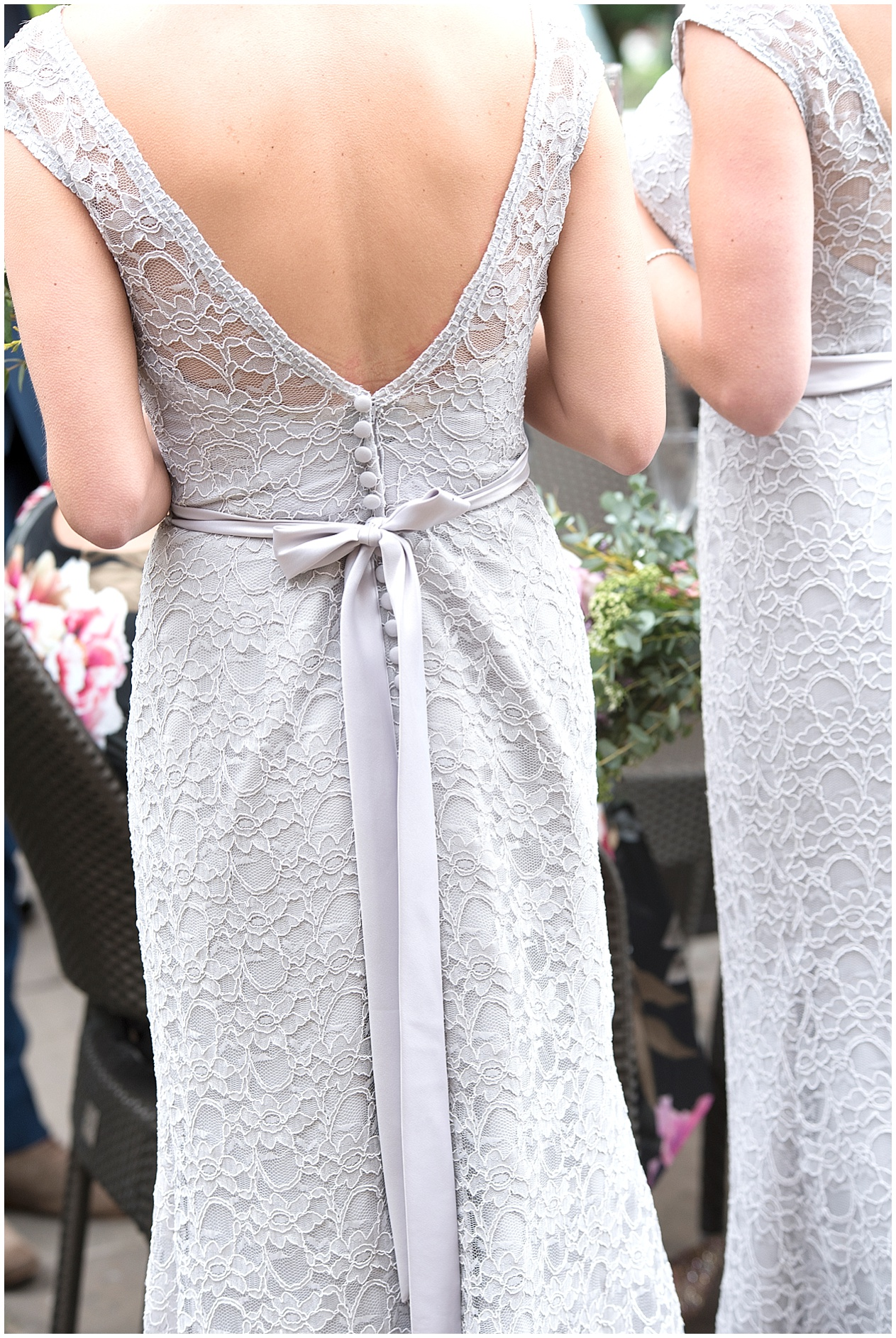 The back of some beautiful bridesmaids dresses.