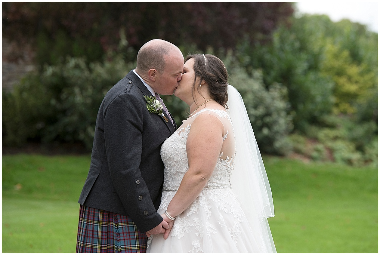 Lancashire wedding photographer. Photograph of a bride and groom kissing on their wedding day.
