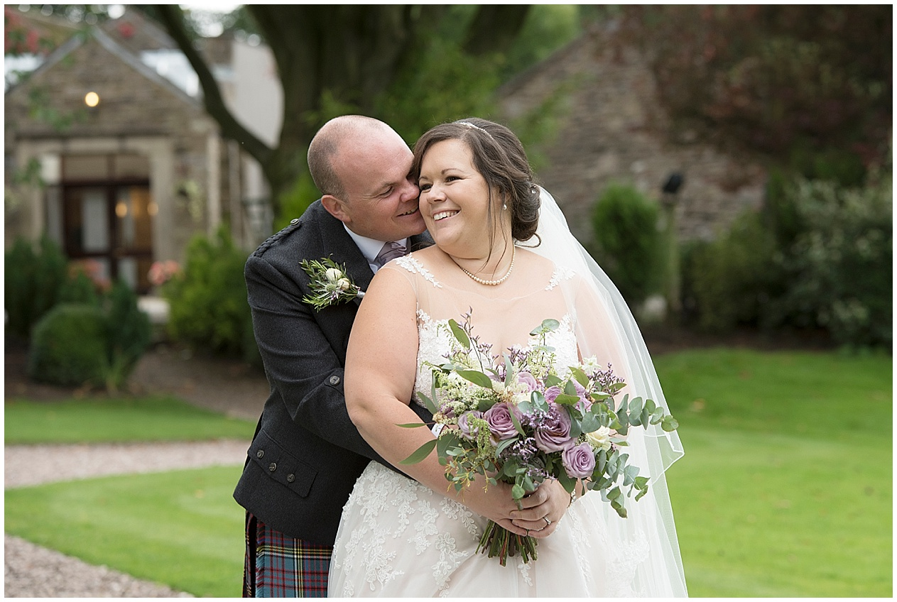 Bride and groom pictured smiling together on their wedding day. Stirk House wedding Photography.