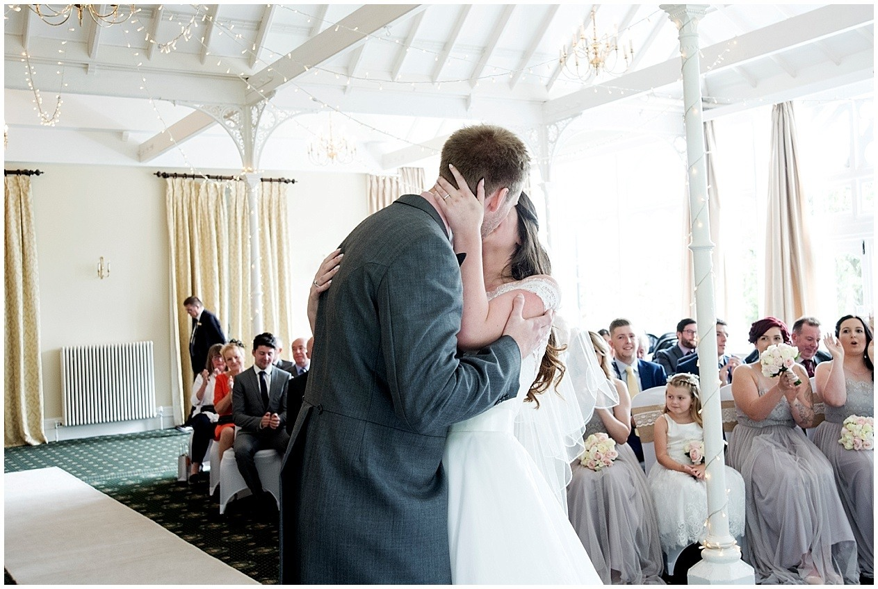 Bride and groom's first kiss. The old swan hotel in Harrogate wedding photography.