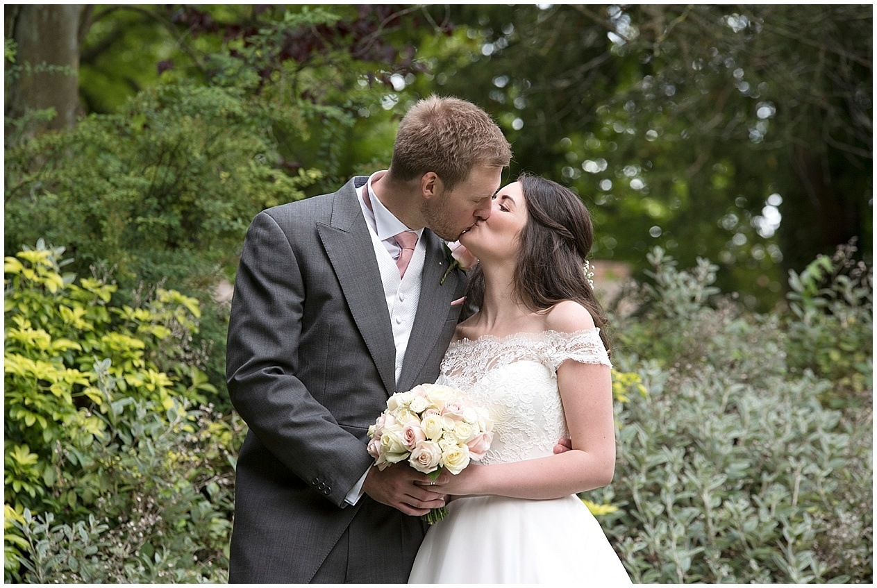Bride and groom share a kiss on their wedding day at The Old Swan Hotel in Harrogate, Yorkshire wedding photographer.