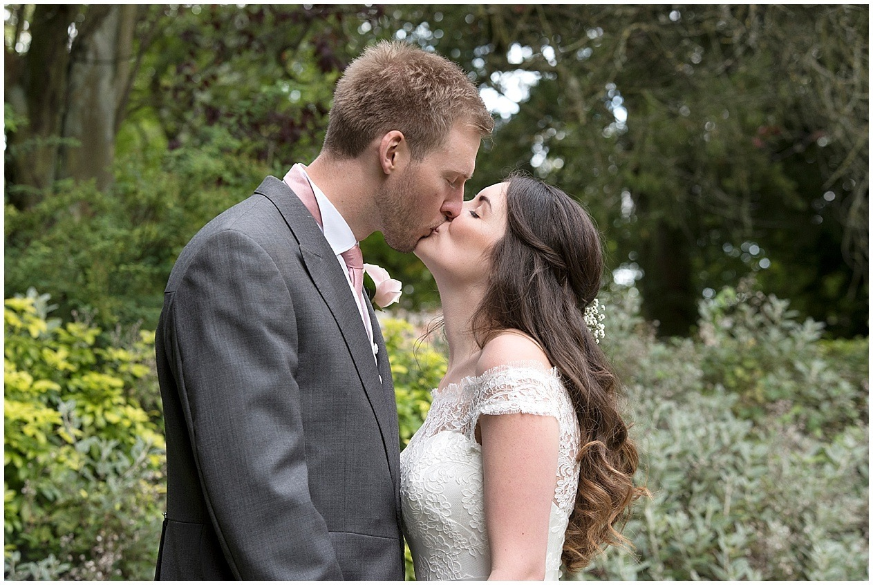 Bride and groom share a kiss on their wedding day at The Old Swan Hotel in Harrogate.