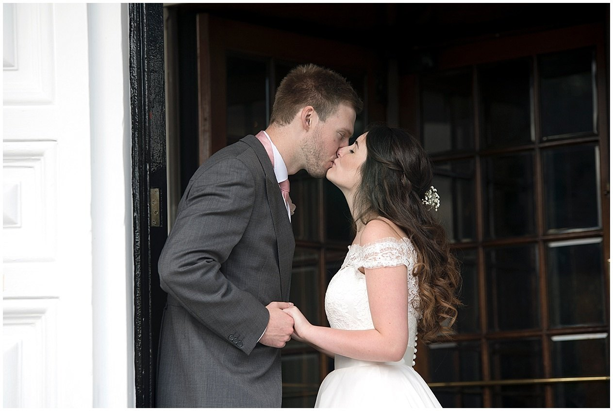 Bride and groom share a kiss at the Old swan hotel in Harrogate.