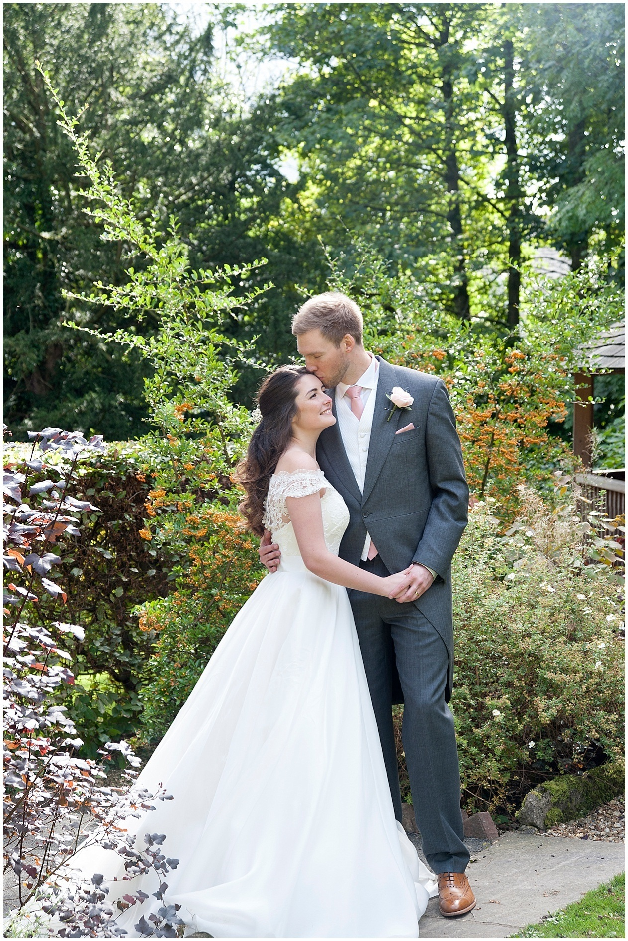 The Old Swan Hotel in Harrogate wedding photography. Bride and groom pictured together in the hotel gardens