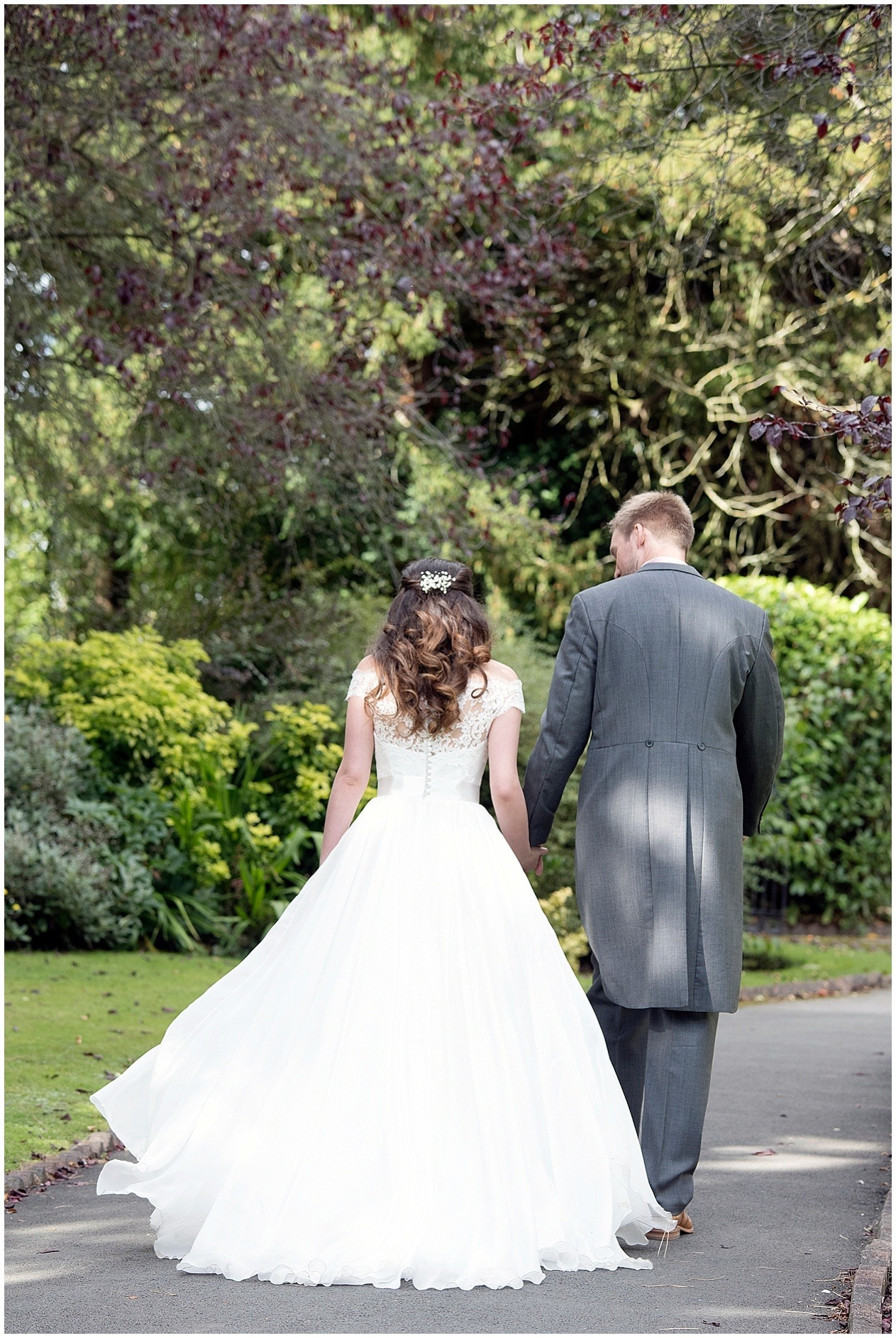 Bride and groom stroll hand in hand on their wedding day in Harrogate. Yorkshire wedding photographer