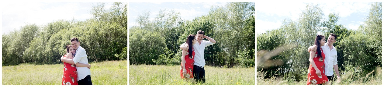 A couple walk through the long summer grass on their pre wedding shoot at Brockholes nature reserve.