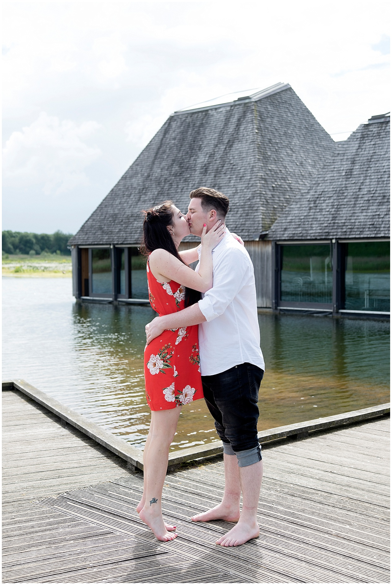 A couple share a kiss on their engagement photoshoot at Brockholes nature reserve in Preston.