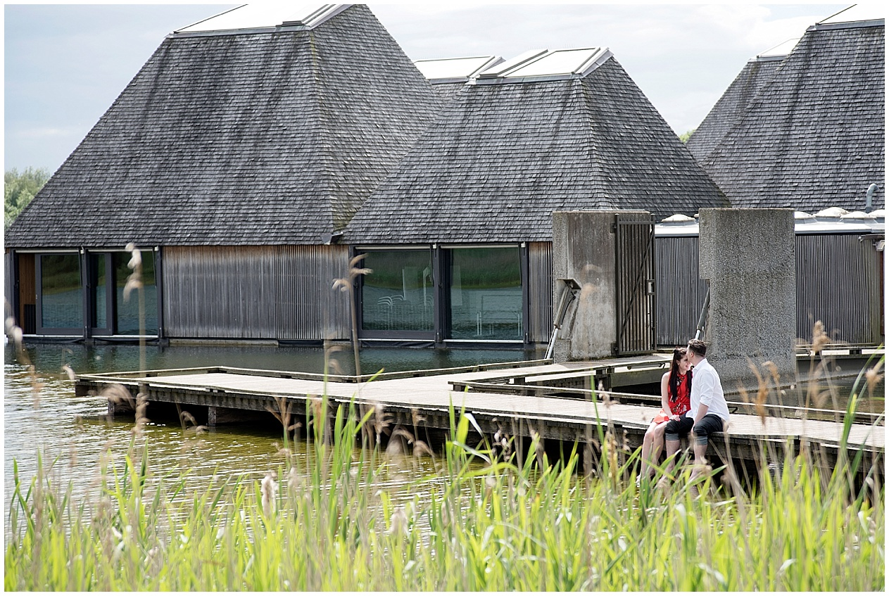 A young couple share a kiss amongst the reeds at Brockholes nature reserve.