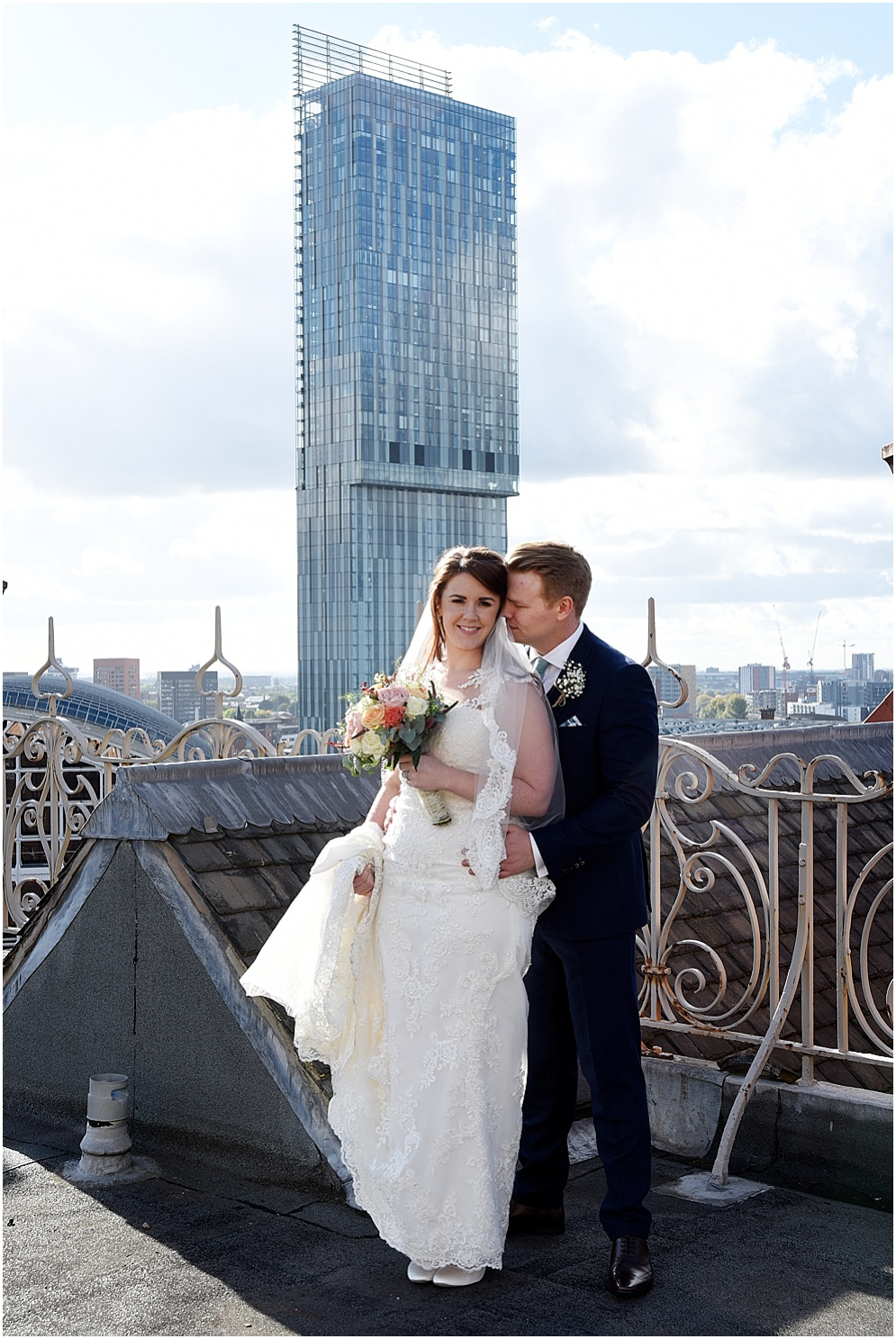 Bride and groom on the roof of the Midland Hotel in Manchester on their wedding day