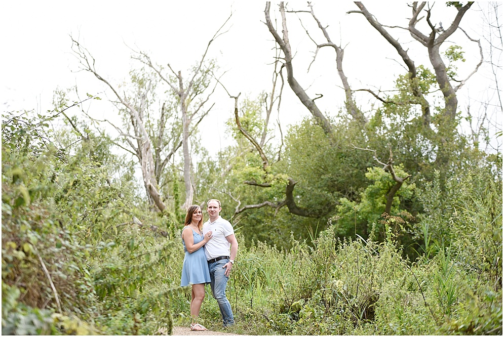 A couple pictured amongst the trees on their pre wedding shoot. Hitchin wedding photography