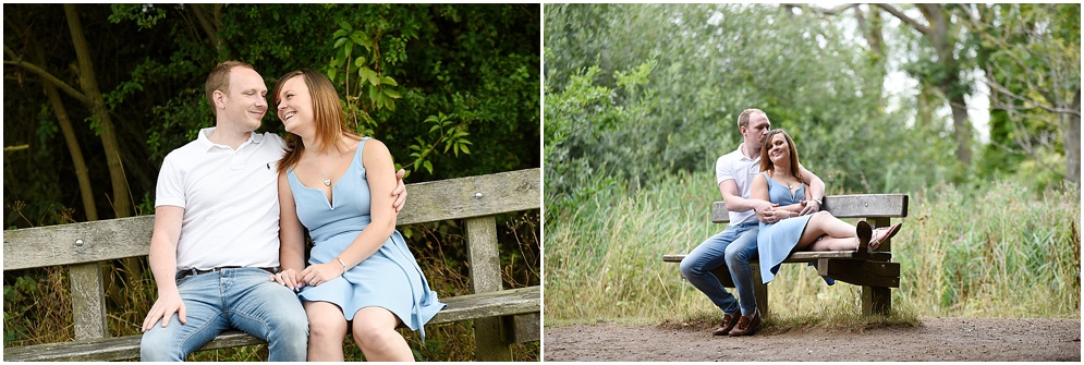 Smiling bride and groom sit on a bench during their pre wedding photography session at Oughtonhead common in Hitchin