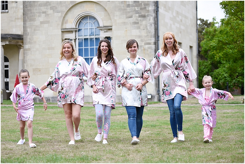 Bride and her bridesmaids pictured on her wedding at Hitchin Priory.