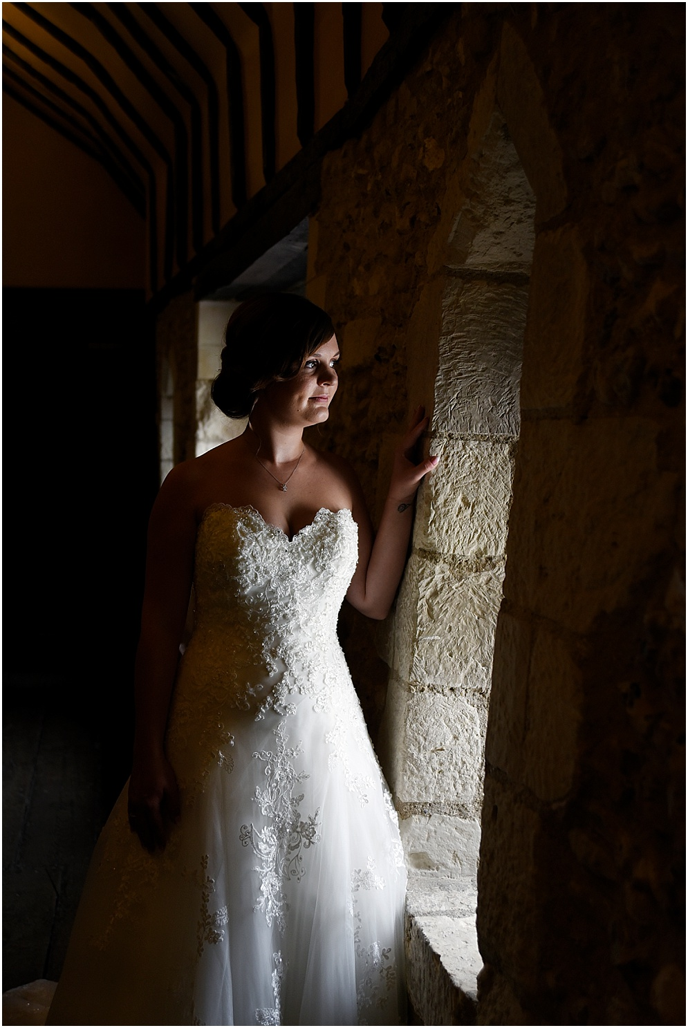 Bride pictured in her dress on her wedding day morning. Hitchin Priory wedding photography.