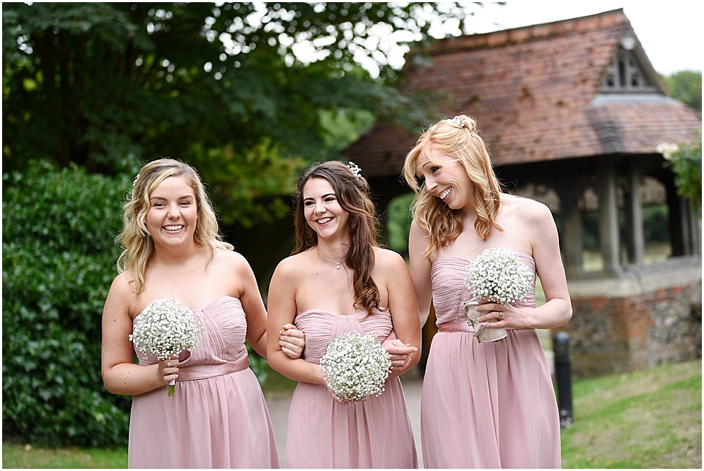 Beautiful bridesmaids in pink. Hertfordshire wedding photographer.