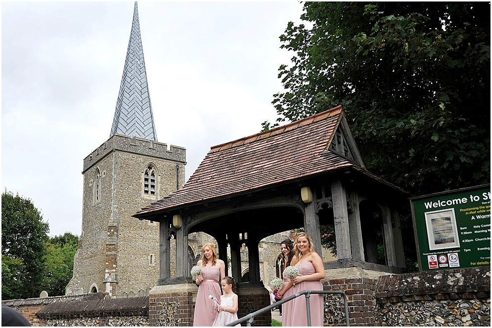 Bridesmaids outside St Nicholas church in Stevenage.