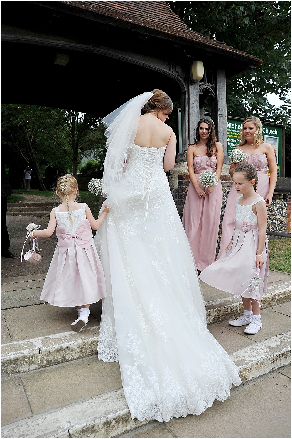 Bride and her bridesmaids arrive at church.