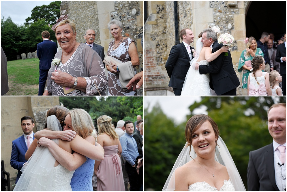 Guests smile outside church at a wedding in Hertfordshire.