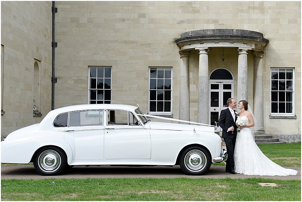 Weddings at Hitchin Priory. The bride and groom with their wedding car.