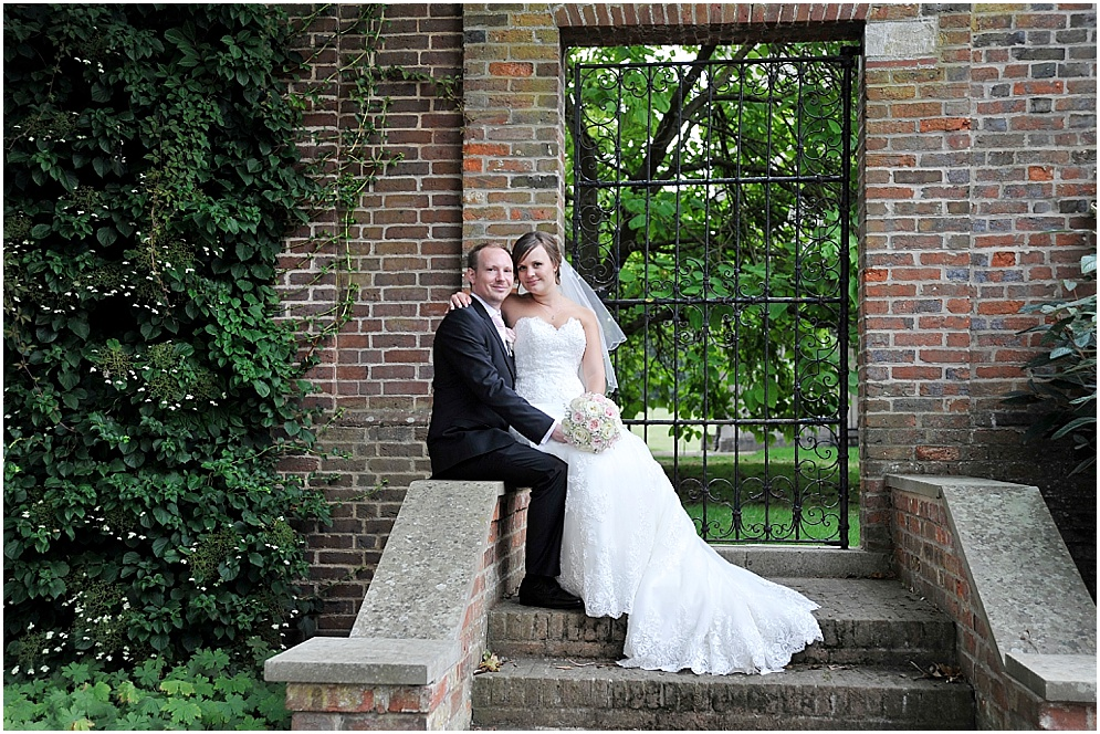 Bride and groom pictured on their wedding. Hitchin Priory wedding photography.
