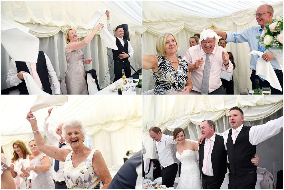 The singing waiters entertain the guests at a wedding at Hitchin Priory.