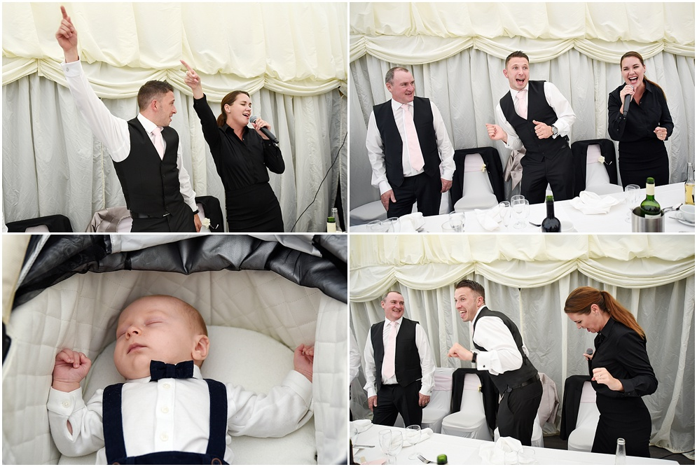 Guests join in with the singing waiters during a wedding at Hitchin Priory.