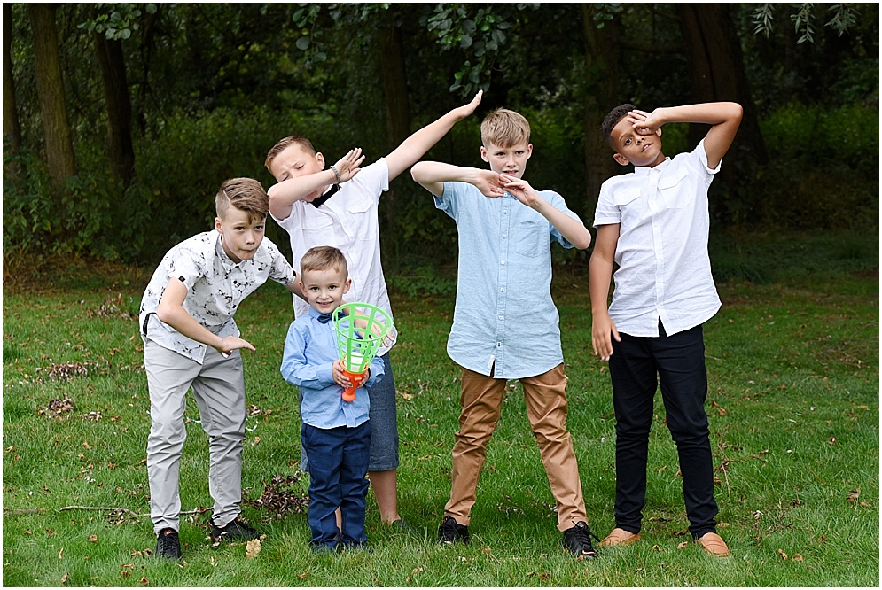 Children do the dab at a wedding.