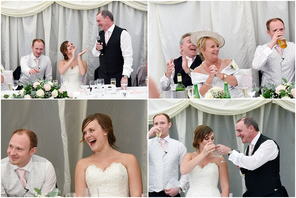 Bride laughs at the speeches at her wedding at Hitchin Priory.
