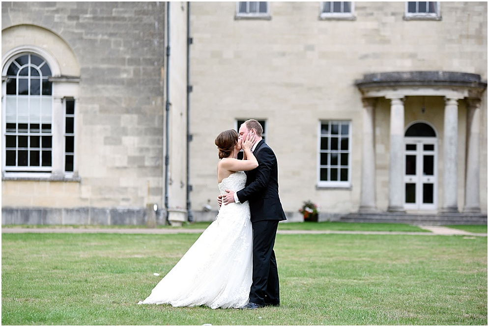 Bride and groom share a kiss on their wedding day. Hitchin Priory wedding photography.