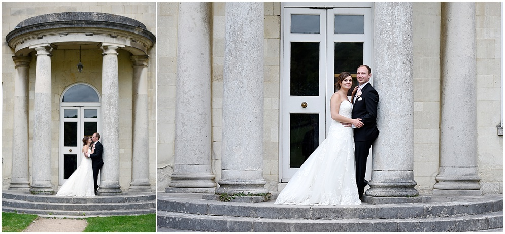 Bride and groom pose for photographs on the steps of Hitchin Priory in Hertfordshire.