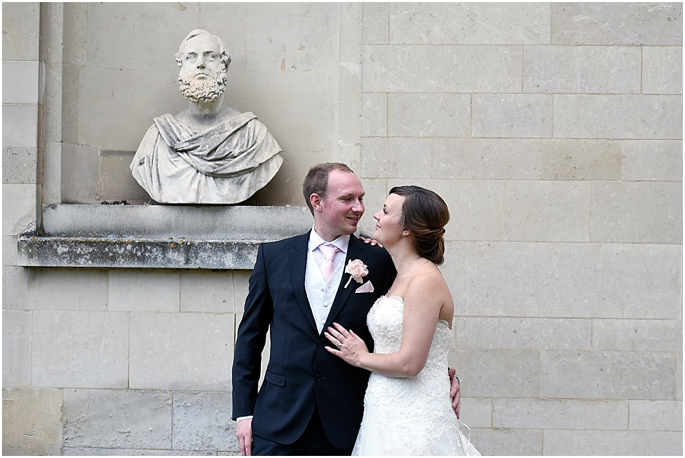 Hitchin Priory wedding. Photograph of the bride and groom by the statue outside.