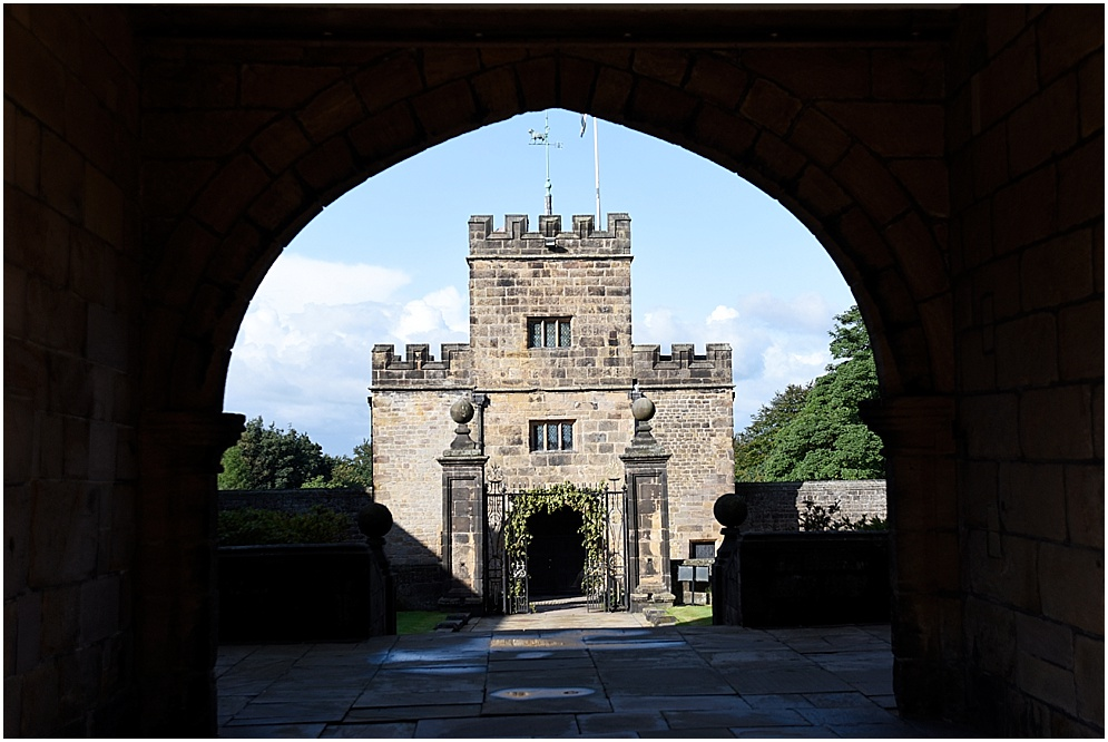 Photography of one of the tower at Hoghton Tower through an archway